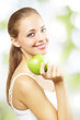 Smiling girl with green apple