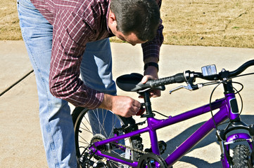 Man Fixing Child's Bicycle
