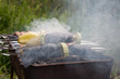 vegetables are roasted over a fire