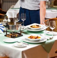 Waiter Serving Food at Restaurant