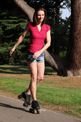 Tall long legged girl has fun roller skating