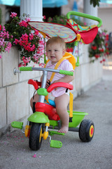 Cute baby girl on her first bike
