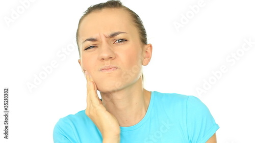 Young attractive woman with a terrible toothache, isolated