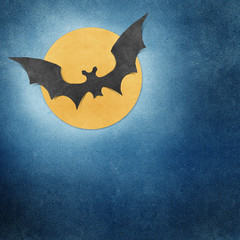 Halloween bat and full moon recycled papercraft background