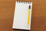 Open notepad and pencil