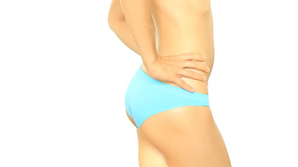 Woman checking skin on her buttock, isolated on white