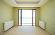 Empty small room with sea view balcony