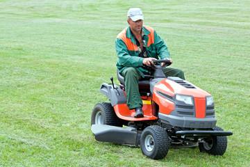 Gardener mowing lawn