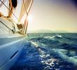 Leinwandbild Motiv Yacht Sailing against sunset.Sailboat.Sepia toned