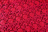 Detail of red lace pattern fabric