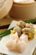 Dimsum by a bamboo basket  [chinese food ]