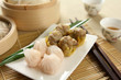 Dimsum by tea cups and bamboo steamer