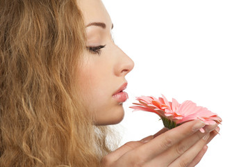Beautiful woman with flower in her hands
