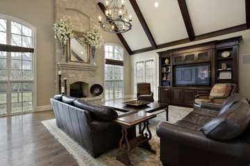 Family room with two story stone fireplace