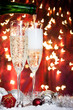 champagne glasses and christmas decoration and bottle