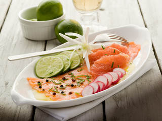salmon carpaccio with slice grapefruit, lime and radish