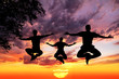 jumping Yoga silhouettes in lotus