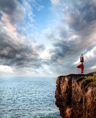 Woman doing yoga vrikshasana tree pose