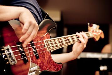 musician playing a guitar