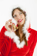 portrait of female Santa Claus with a bell