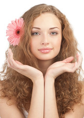 Beautiful woman with flower in her hair