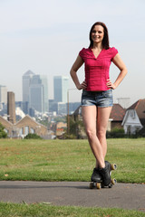 Beautiful woman roller skating in London England