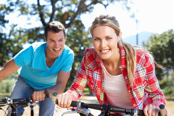 Young couple on country bike ride