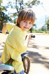 Little boy on country bike ride