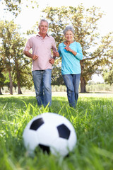 Senior couple playing football