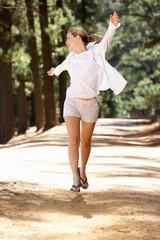 Woman running along country lane