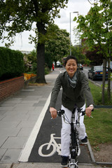 Asian woman on bicycle