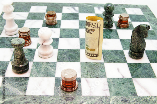 coins and money on a chess board
