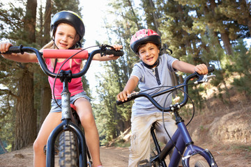 Young children on bikes in country
