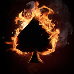 Card symbol spade, covered in flames.