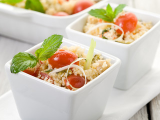 vegetable couscous with cerry tomatoes and mint leaf