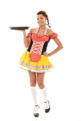 A young and attractive brunette bavarian woman holding a plate
