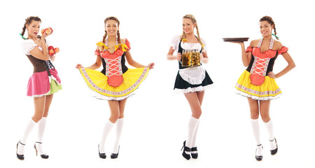 Four young bavarian women in dresses and holding food