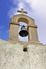 Bell tower of small chapel in Maroulas