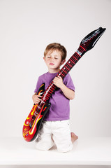 boy playing on a guitar