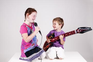 two kids making music