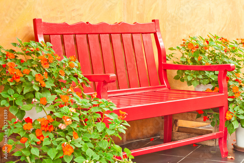 red color armchair in the garden