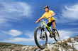 Young man riding a mountain bike outdoor