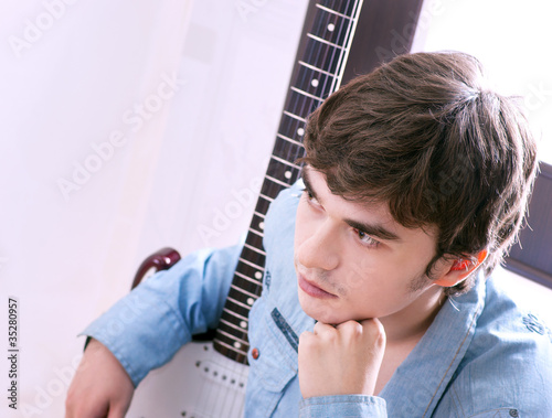 young handsome guy with a guitar