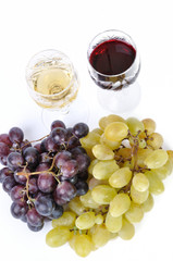 Glasses of wine with grapes isolated in white