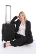 Beautiful business woman traveller with suitcase