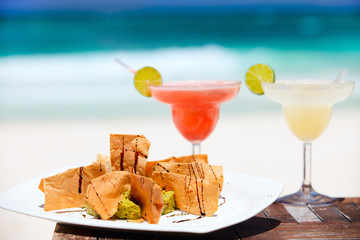 Tortilla chips and margarita cocktails