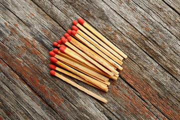 Group of matches on wooden texture