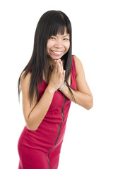 Asian woman with hands clasped