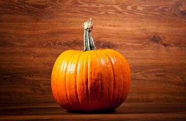 Ripe pumpkin fruits on wooden background