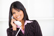 happy indian businesswoman on the phone